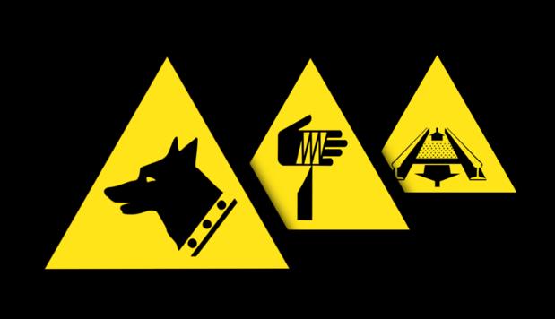 Warnschilder in verschiedenen Normen